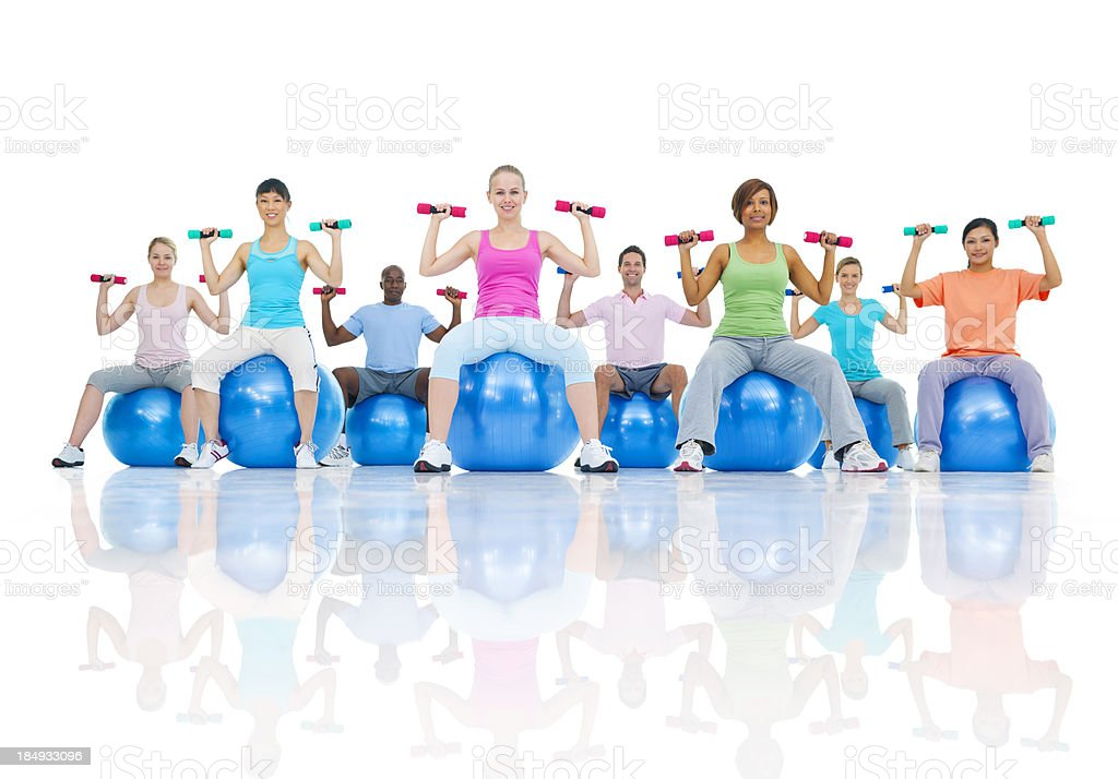 Diverse fitness class using weights and balls. stock photo