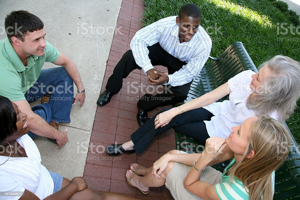 Diverse Group Discussing Outside royalty-free stock photo