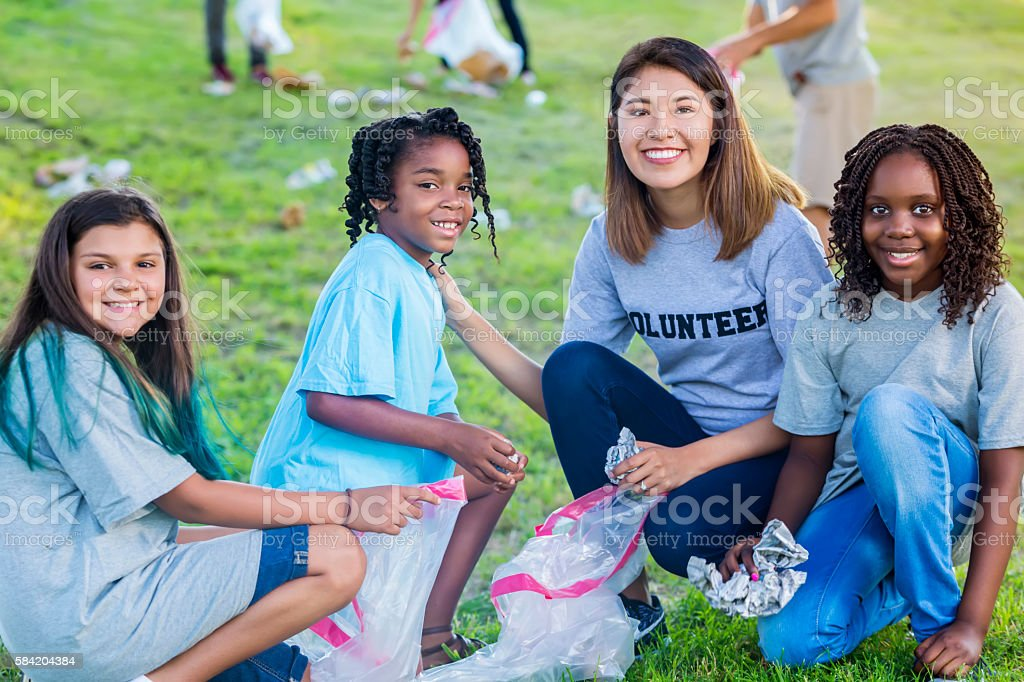 Diverse group helps with community clean up stock photo