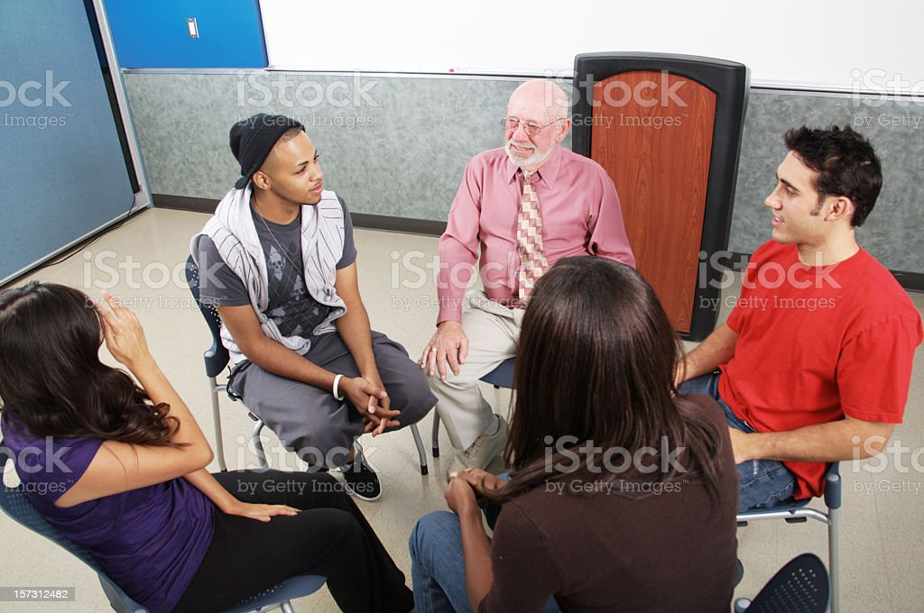 A diverse group in a circle for mental health counseling royalty-free stock photo