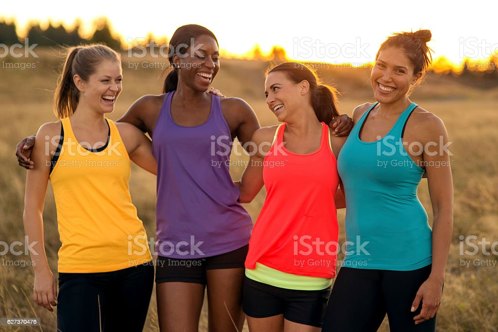 Diverse group of adult female athletes after trail running stock photo