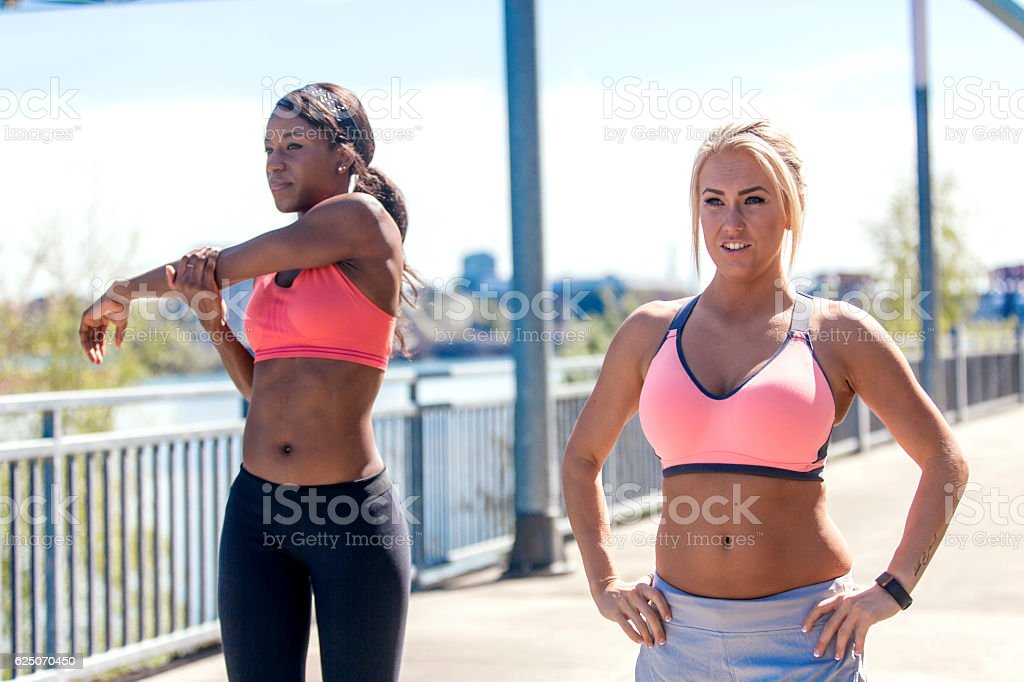 Diverse group of adult females ready to go jogging stock photo