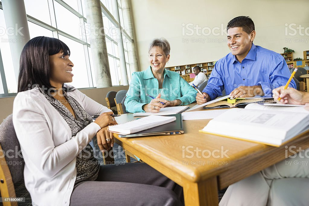 Diverse group of adult students studying for college exam stock photo