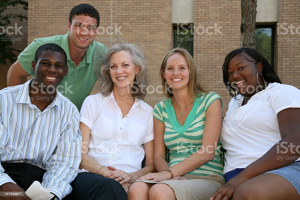 Diverse Group of Adults Happy and Sitting Together royalty-free stock photo