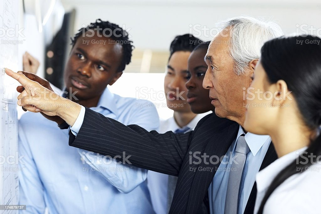 Diverse group of architect discussing on a new building plan royalty-free stock photo