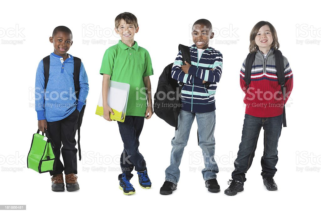 Diverse group of boys ready for school class with backpacks royalty-free stock photo
