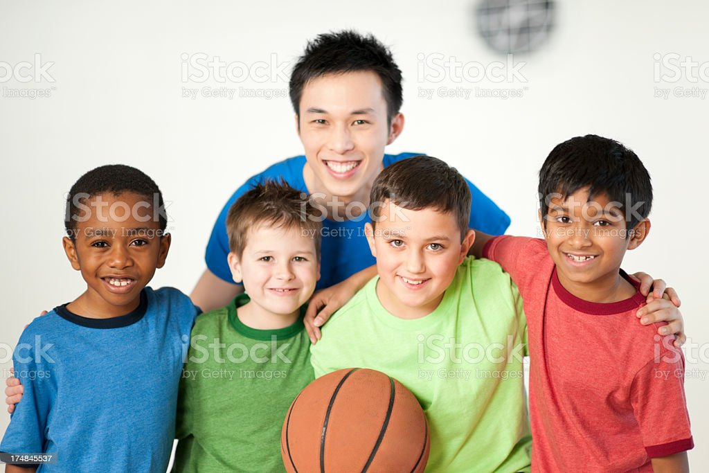 Diverse group of boys with basketball royalty-free stock photo