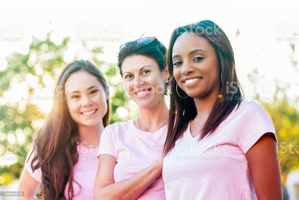 Diverse group of breast cancer survivors and awareness supporters stock photo