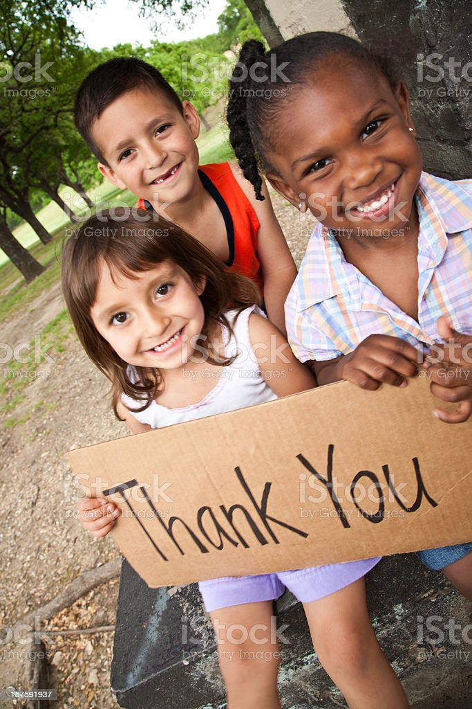 Diverse Group of Children Holding Thank You Sign royalty-free stock photo