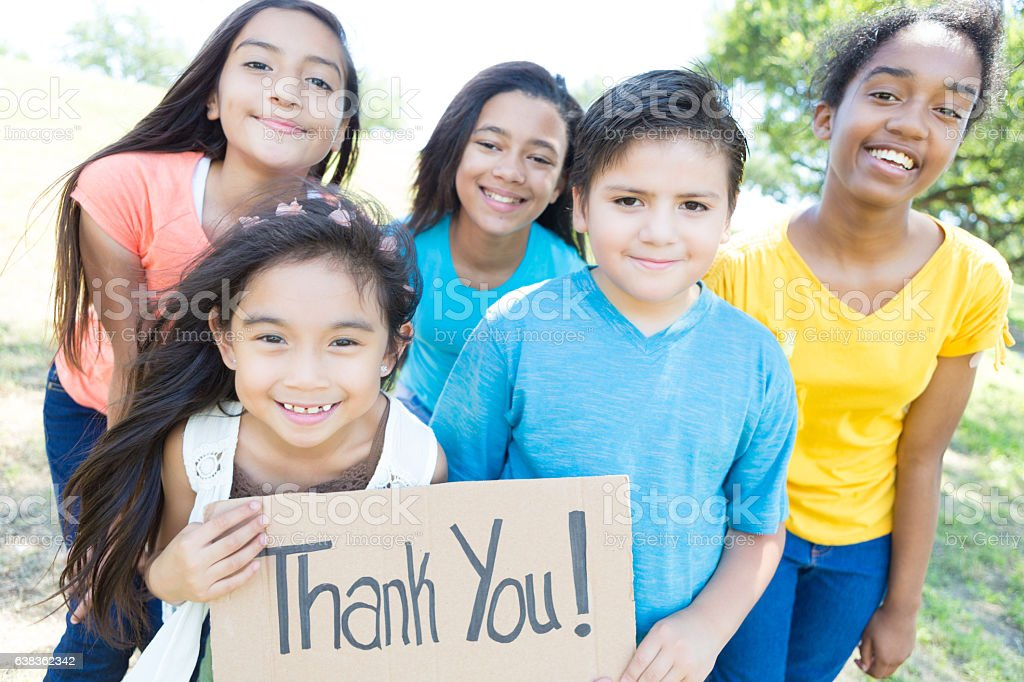 Diverse group of children with 'Thank You' sign stock photo