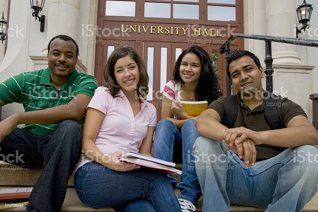 Diverse Group of College Friends Sitting royalty-free stock photo