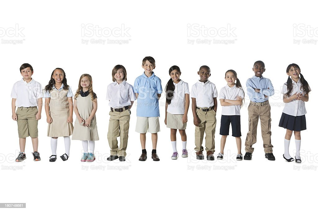 Diverse group of elementary school age children in uniforms stock photo