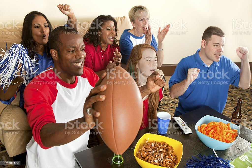 Diverse Group of Family and Friends Watching a Football Game stock photo