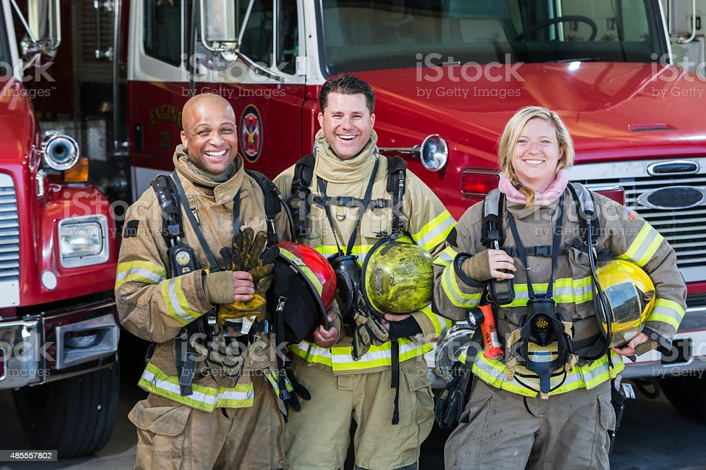 Diverse group of fire fighters at the station stock photo