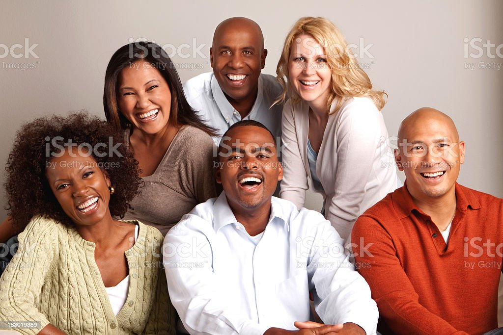 Diverse group of friends laughing stock photo