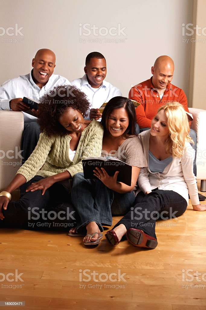 Diverse group of friends reading stock photo
