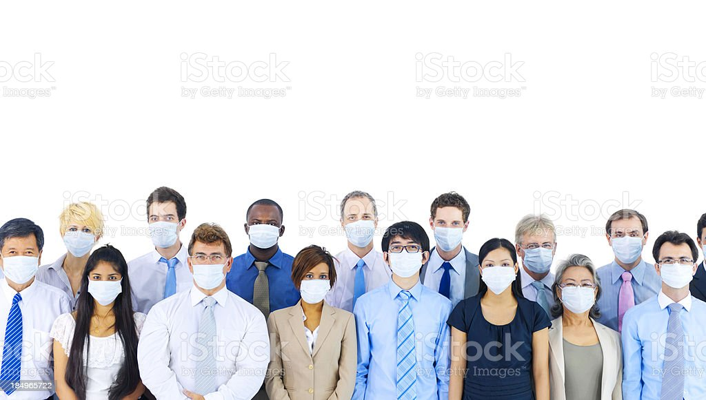 Diverse group of international business people wearing masks. stock photo