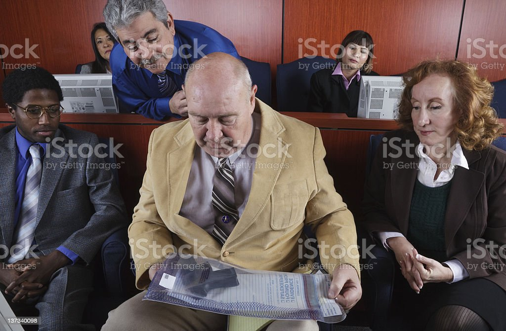 Diverse Group of Jurors Looking at Evidence stock photo