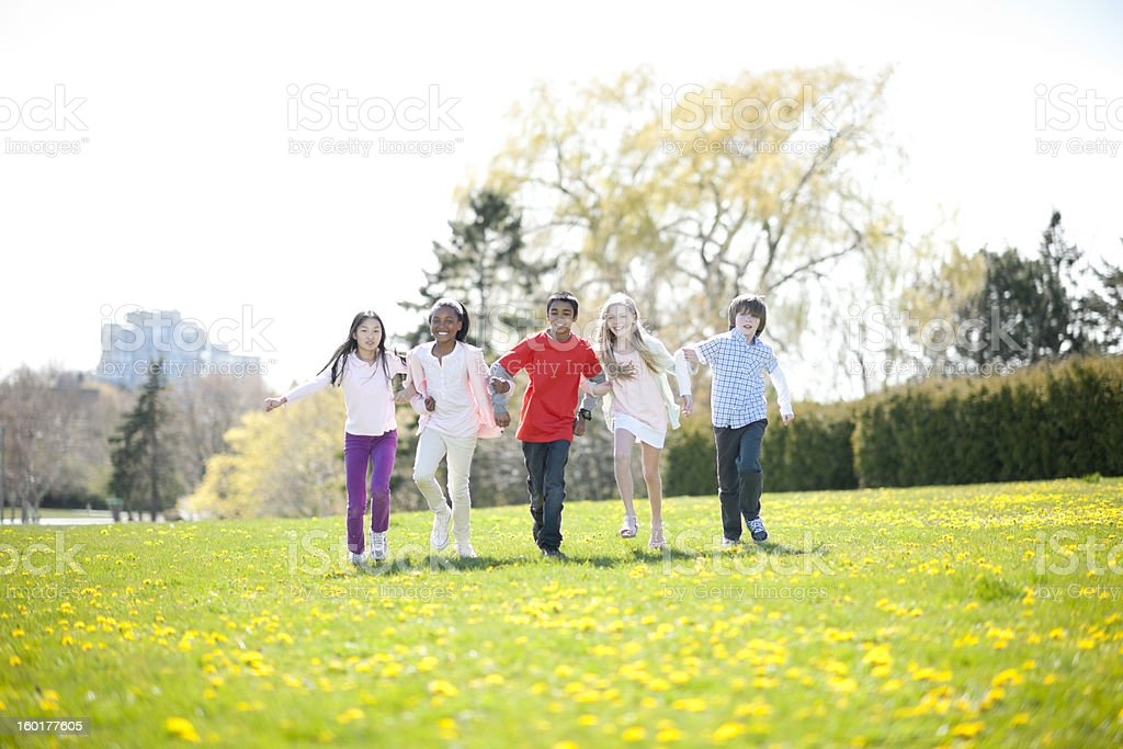 Diverse group of kids in park royalty-free stock photo