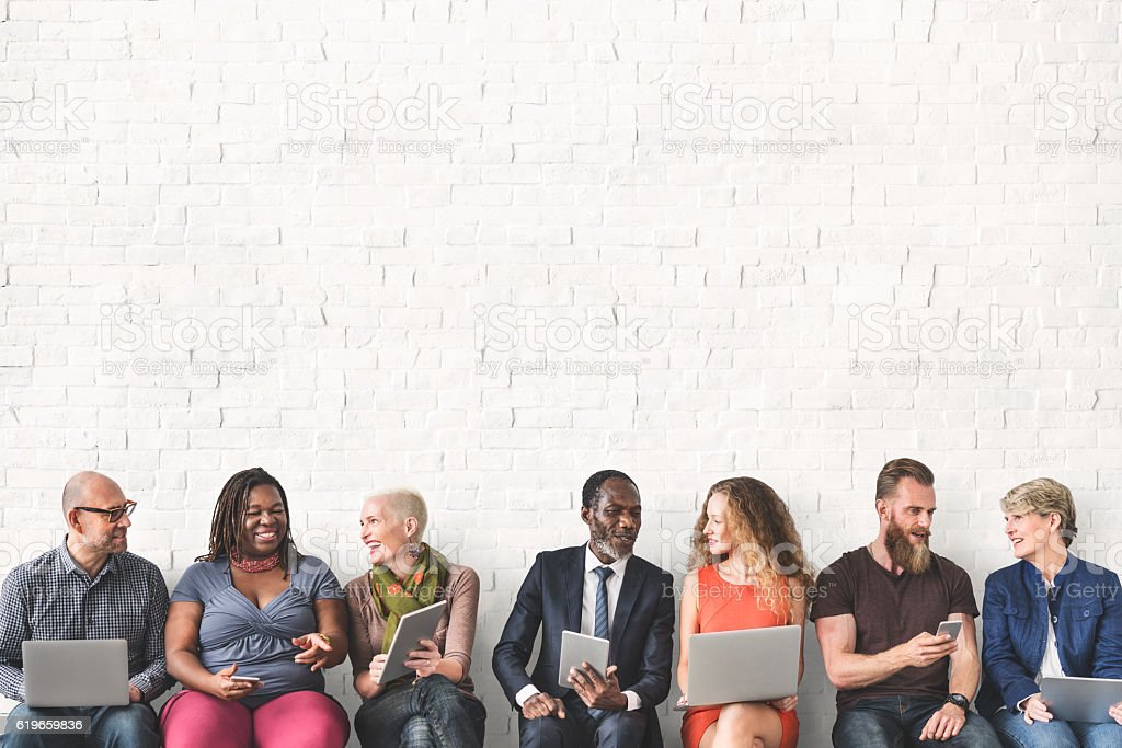 Diverse Group of People Community Togetherness Technology Sittin stock photo
