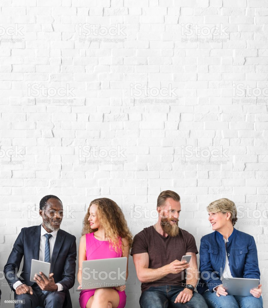 Diverse Group of People Community Togetherness Technology Sitting Concept stock photo
