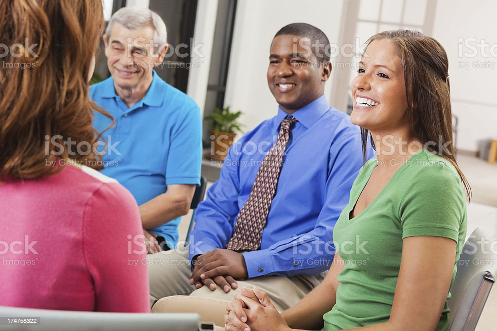 Diverse group of people having support or team meeting royalty-free stock photo