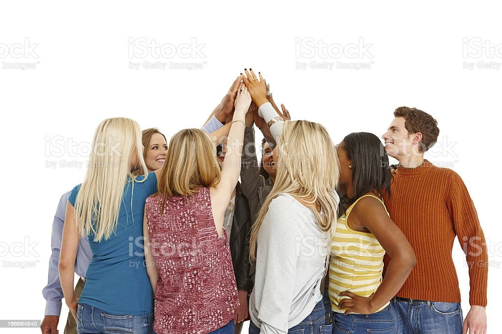 Diverse group of people joining hands royalty-free stock photo