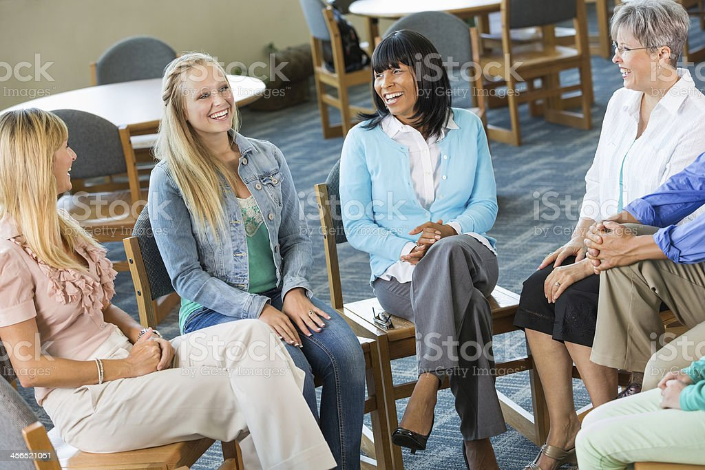Diverse group of people meeting together for discussion and support stock photo