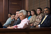 A diverse group of people sitting in a courtroom