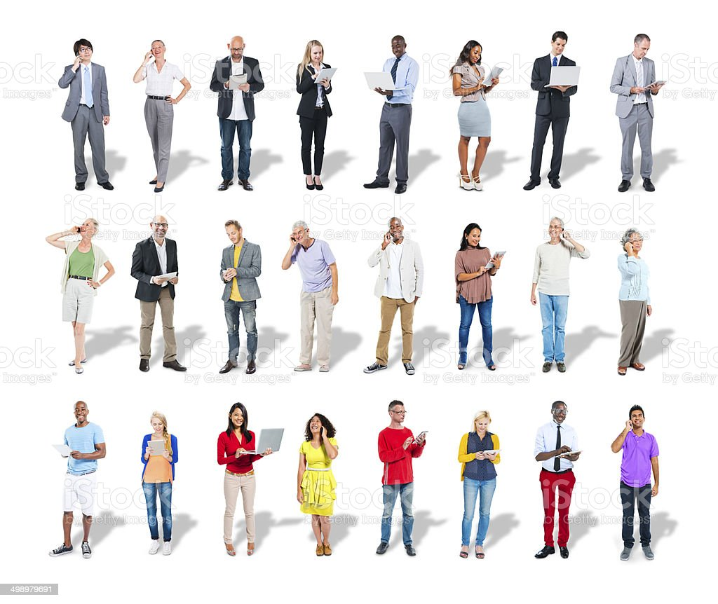 Diverse group of people use digital devices stock photo