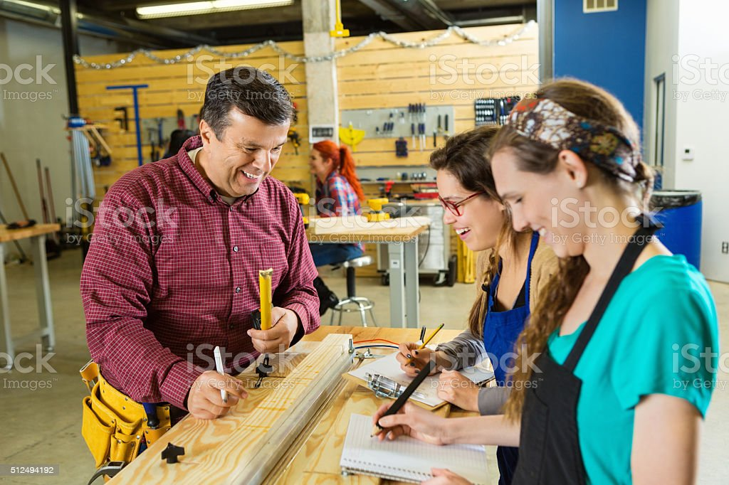 Diverse group of people work in workshop stock photo