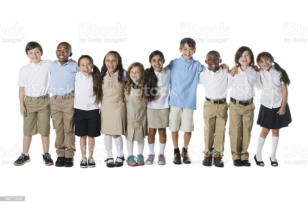 Diverse group of private elementary school students standing in row stock photo