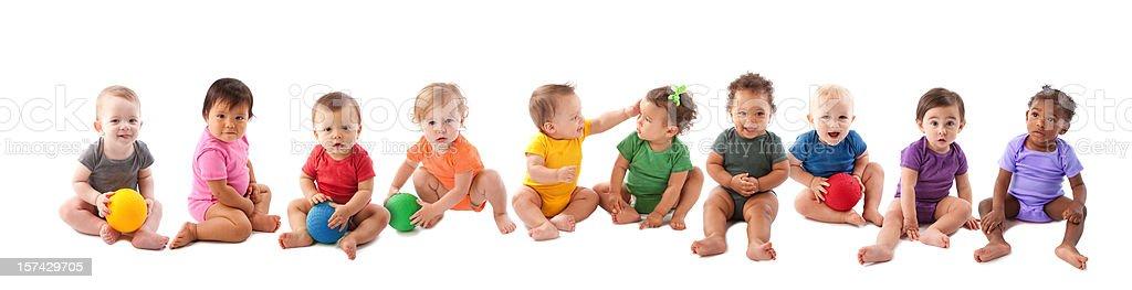 Diverse group of ten babies playing stock photo