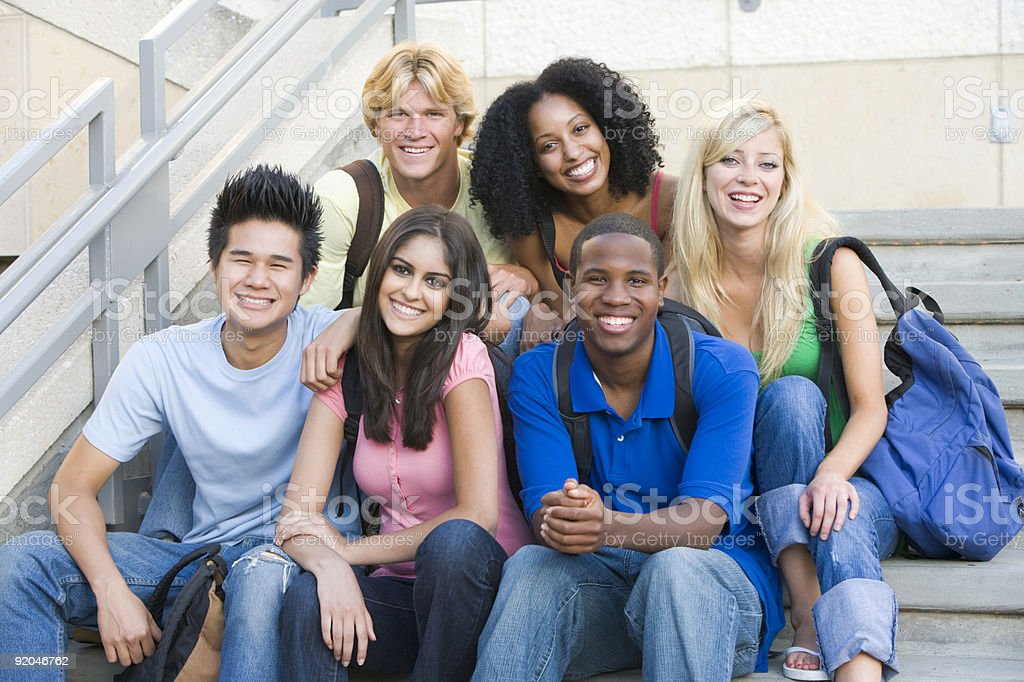 A diverse group of university students sitting on some steps royalty-free stock photo