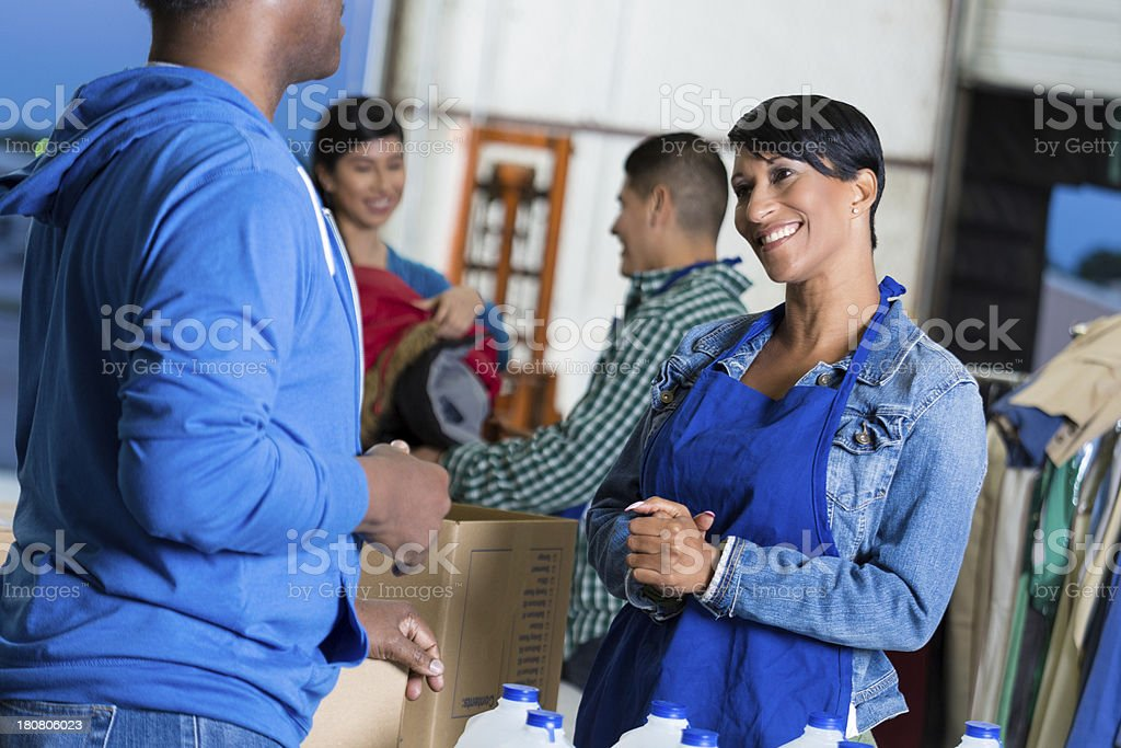 Diverse group of volunteers collecting donations for community stock photo