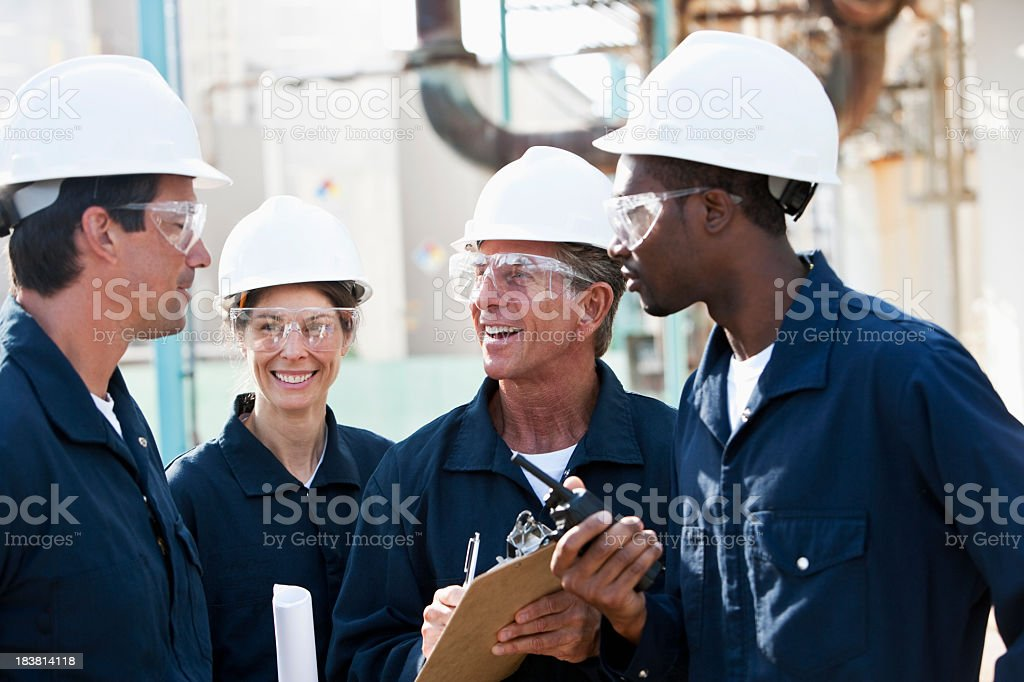 Diverse group of workers at manufacturing plant royalty-free stock photo