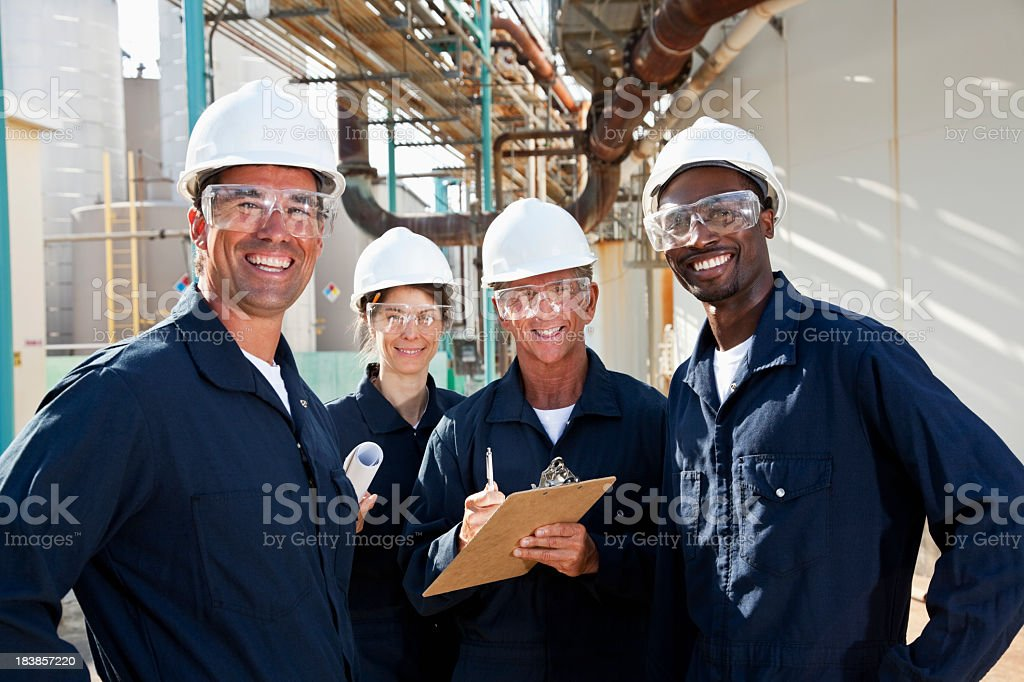 Diverse group of workers at manufacturing plant stock photo