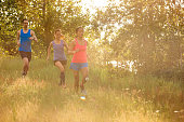 Diverse group of young adult athletes trail running