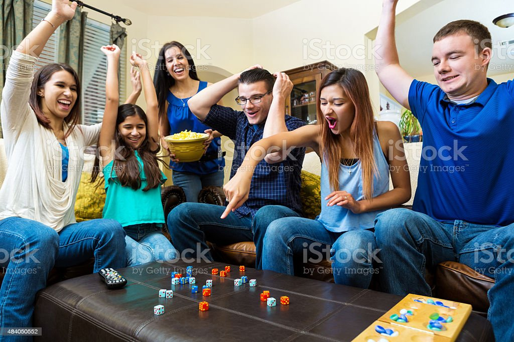 Diverse group of young adult friends playing competitive fun game stock photo
