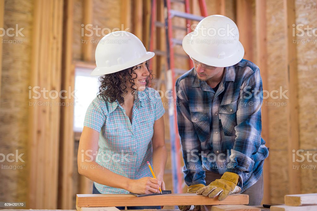 Diverse group of young adults working on DIY construction stock photo