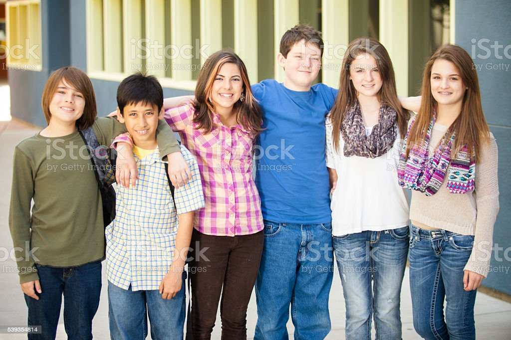 Diverse Group of Young Students Standing Together stock photo