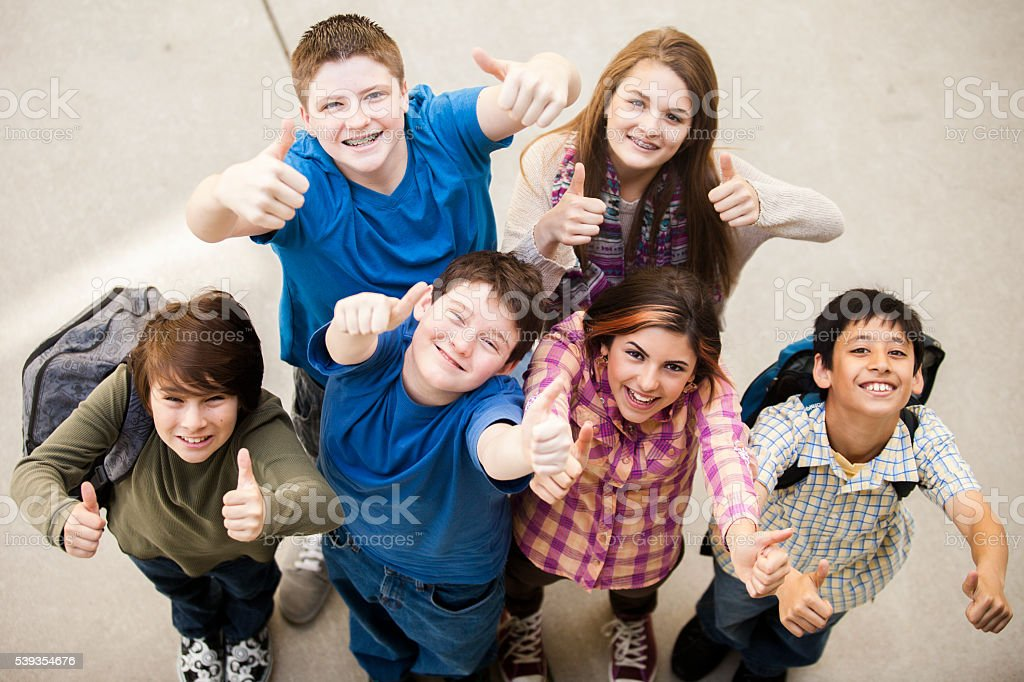 Diverse Group of Young Students Thumbs Up stock photo
