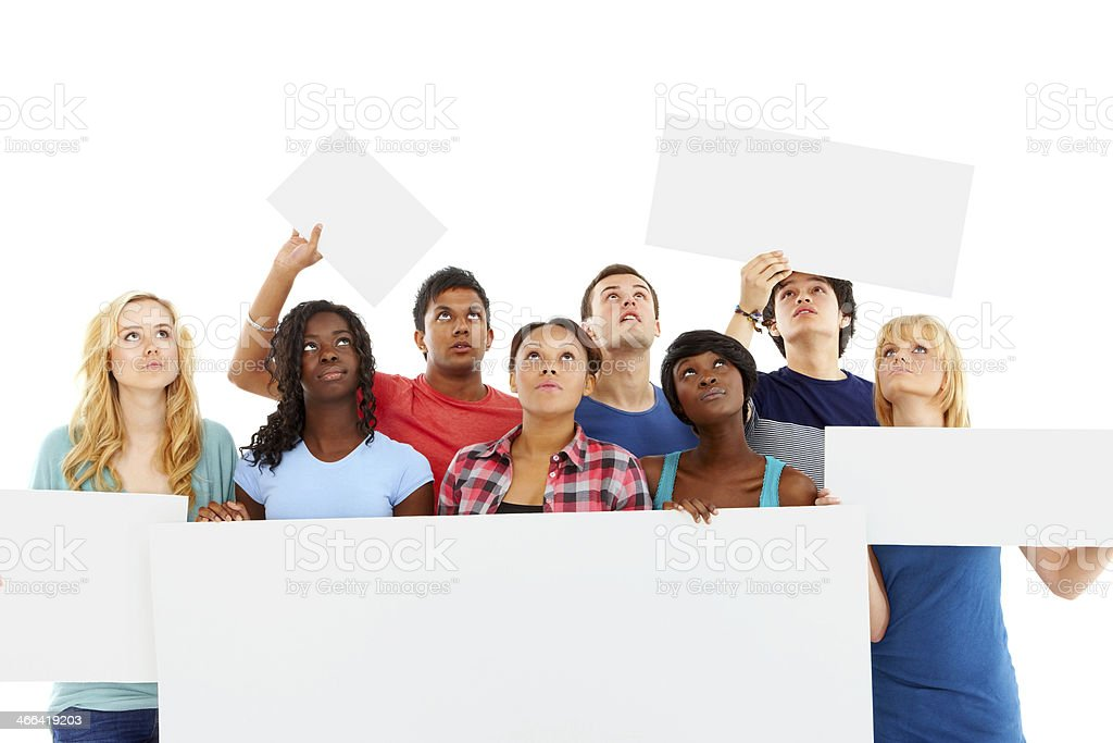 Diverse group of young students with billboards looking up stock photo