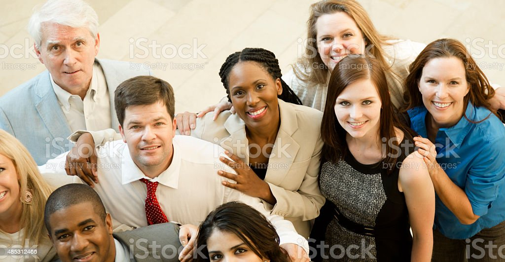 Diverse group office workers, business people in lobby entrance. High-angle. stock photo