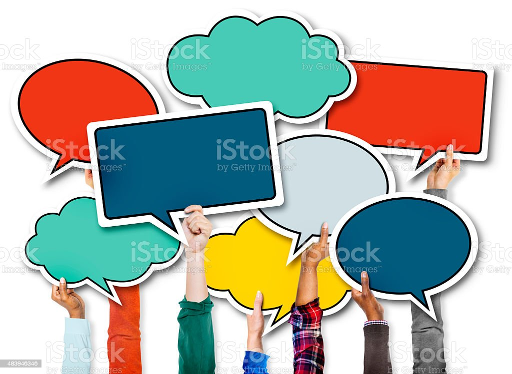 Diverse Hands Holding Colorful Speech Bubbles stock photo