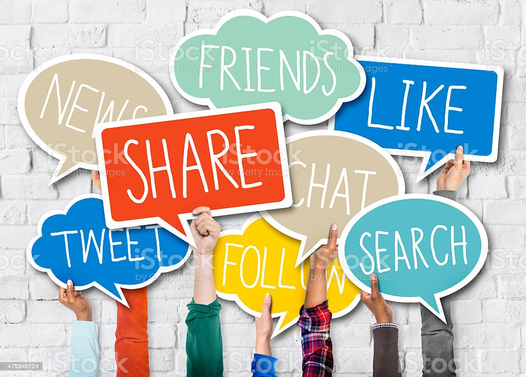 Diverse Hands Holding Colorful Speech Bubbles with Words stock photo