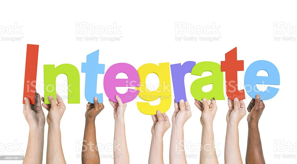 Diverse Hands Holding the Word Integrate stock photo