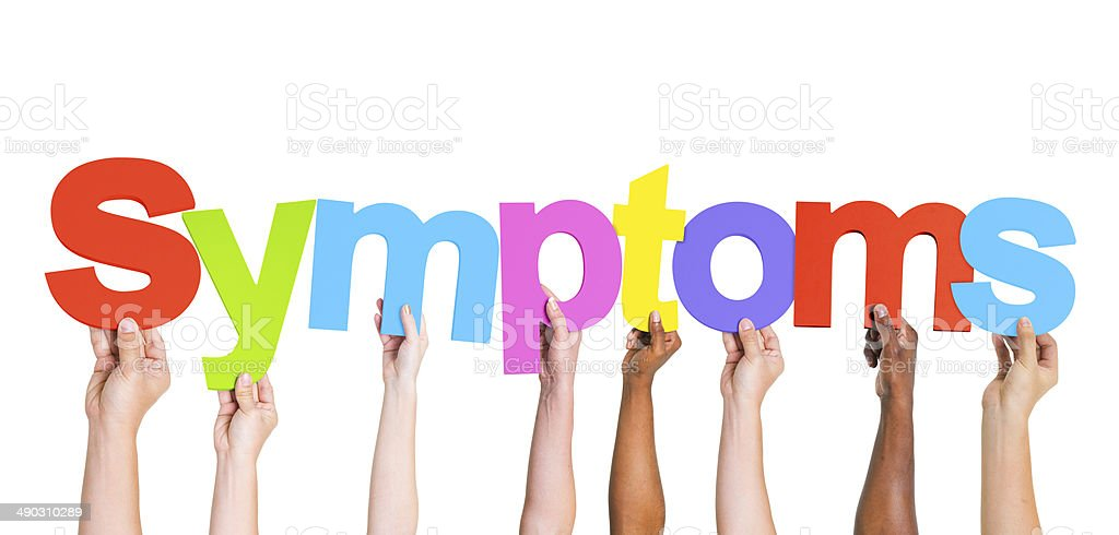 Diverse Hands Holding The Word Symptoms stock photo
