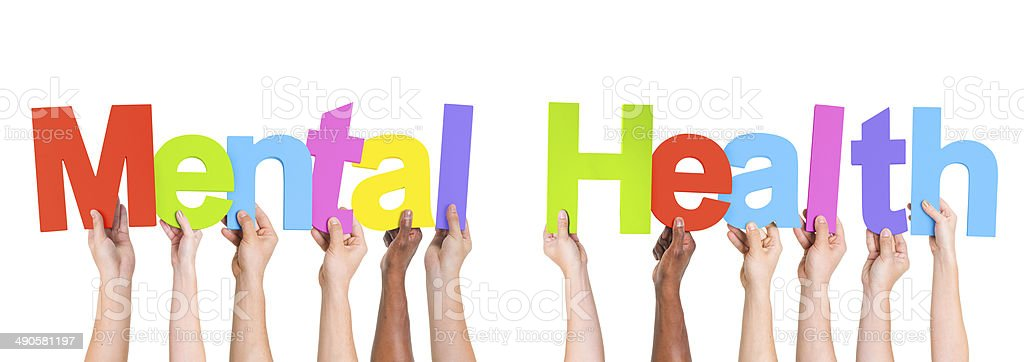 Diverse Hands Holding The Words Mental Health stock photo