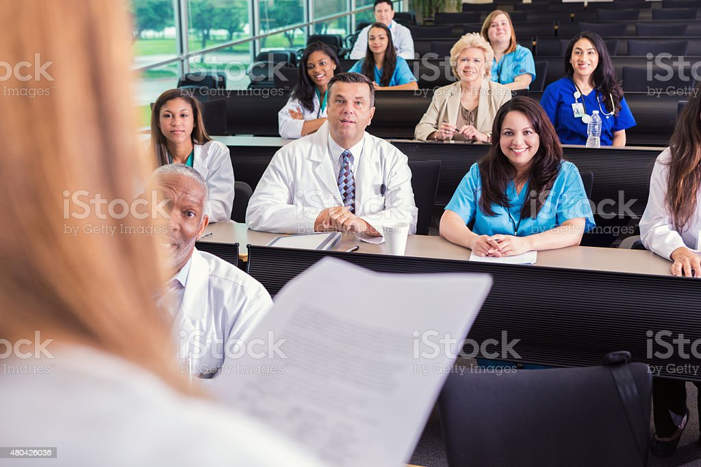 Diverse healthcare professionals attending medical conference or lecture stock photo